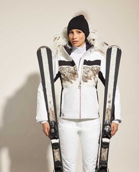 The Limited Edition version of the Amelia ski jacket is embellished with an ostrich and black rooster feather collar and feather inserts on the torso to go with the Hera feather skis.